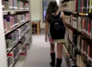Cute school girl come to library for..