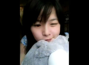 Super-cute asian teenager dancing on..