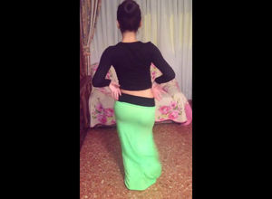 Arab youngster in lengthy sundress..